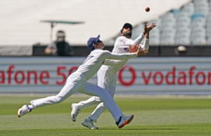 Ravindra Jadeja of India takes a catch ahead of teammate Shubman Gill of India to dismiss Matthew Wade of Australia during day one of the second Test Match between Australia and India at The MCG.