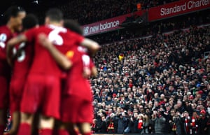 Liverpool fans celebrate their third goal scored by Sadio Mane as the title-hopefuls extended their lead at the top of the table to eight points with a win over City.