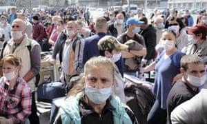 Romanian seasonal workers wait to board flights