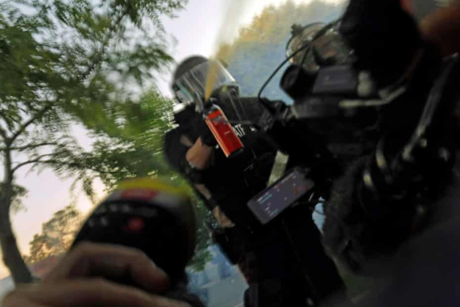 Minnesota State Patrol officers spray journalists with pepper spray at a Black Lives Matter protest in Minneapolis, 5 June