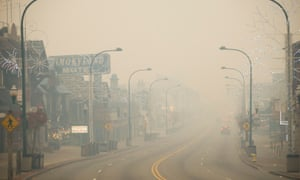 Thick smoke from area forest fires covers streets in Gatlinburg, Tennessee on Tuesday.