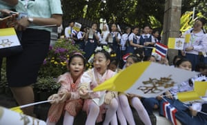 Schoolchildren wait outside the Apostolic Nunciature Embassy of the Holy See