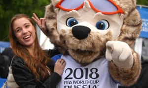 A girl poses for a photo with Wolf Zabivaka, the official mascot of the 2018 FIFA World Cup, at the opening of the 2018 FIFA World Cup Football Park in St Petersburg