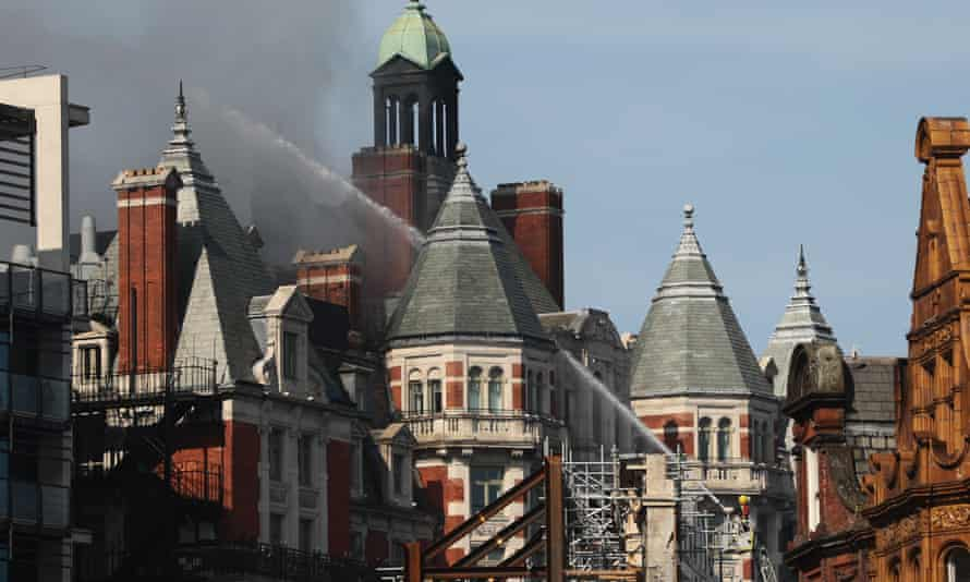 The hotel being hosed with water to get the blaze under control.