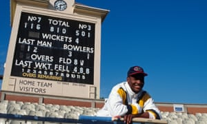 Brian Lara poses by the Edgbaston scoreboard after his world-record innings of 501 not out for Warwickshire against Durham.
