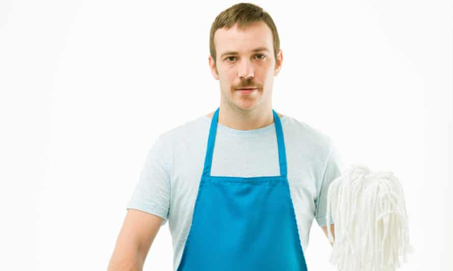 Man in apron with mop