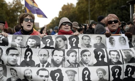 Demonstrators in Madrid show pictures of people killed in Spain during the Franco era.