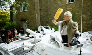 Vivienne Westwood  leads the charge, armed with a yellow duster