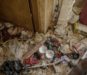 Items including crutches are found on the floor in one house