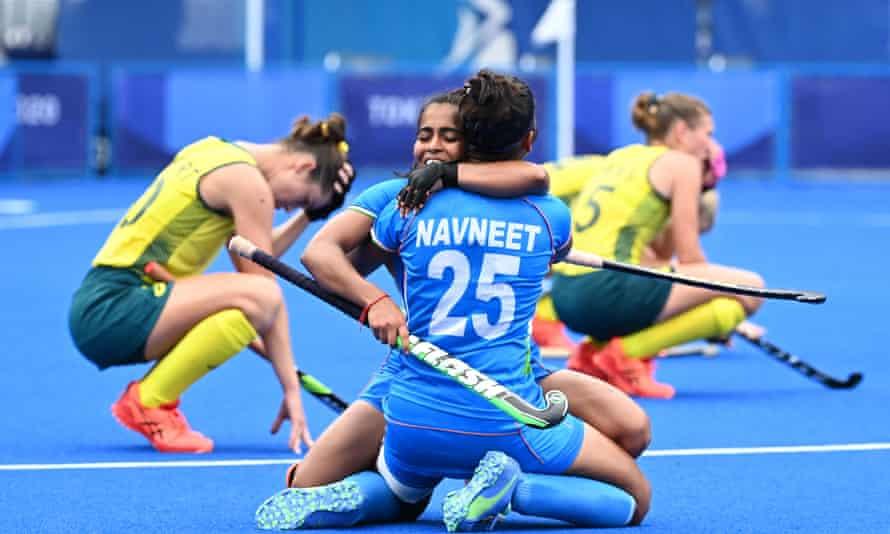 India's Neha and Navneet Kaur celebrate