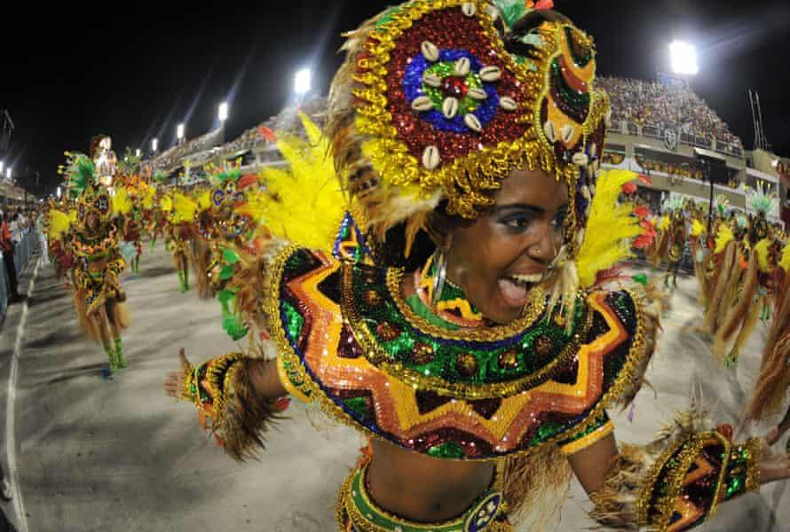 A reveller with Imperatriz samba school dances during the carnival parade at the Sambadrome, Rio de Janeiro, 20 February 2012.