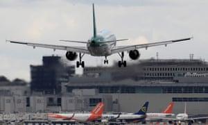 A passenger plane lands in Gatwick.