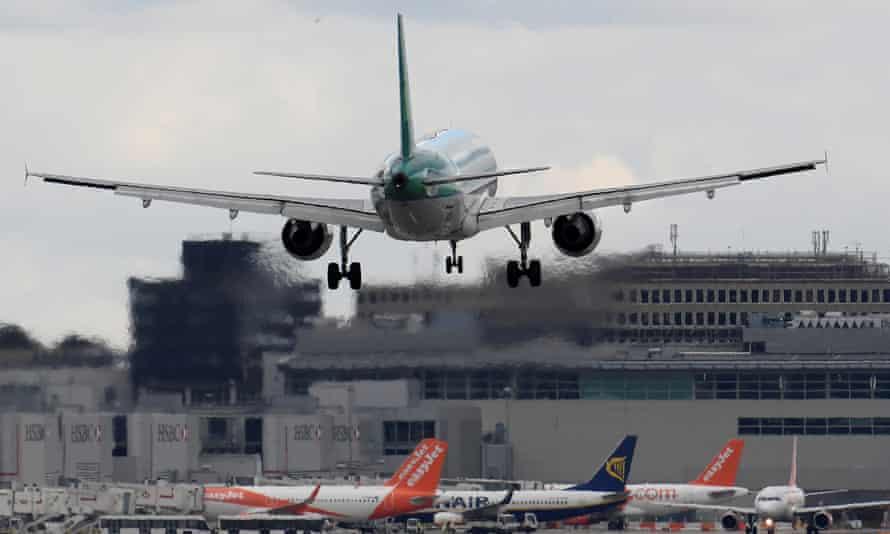 A passenger aircraft lands at Gatwick.