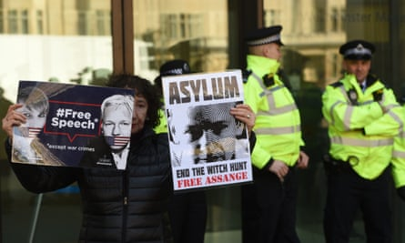 """UK police arrest WikiLeaks founder Julian AssangeLONDON, UNITED KINGDOM - APRIL 11: A protester holds banners reading """"Free Speech - Except War Crimes - Asylum - End The Witch Hunt Free Assange"""" during a protest outside Westminster Magistrates court, in London, United Kingdom on April 11, 2019. The Wikileaks co-founder was arrested earlier today after taking refuge at the Ecuadorian embassy seven years ago to avoid extradition to Sweden. (Photo by Kate Green/Anadolu Agency/Getty Images)"""