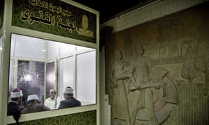 Clerics wait to answer commuters' questions inside a fatwa kiosk at al-Shohada metro station in Cairo.