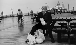 A man eats fish and chips on Eastbourne pier, 2018.
