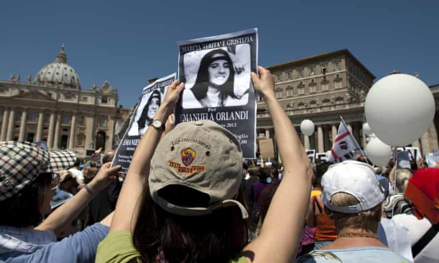 Protesters in 2012 hold pictures of Emanuela Orlandi, who was 15 when she went missing. The remains found recently belonged to an ancient Roman man.