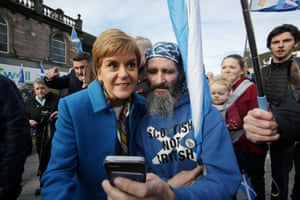 Scottish First Minister Nicola Sturgeon greets supporters during a visit to the Syrian Café