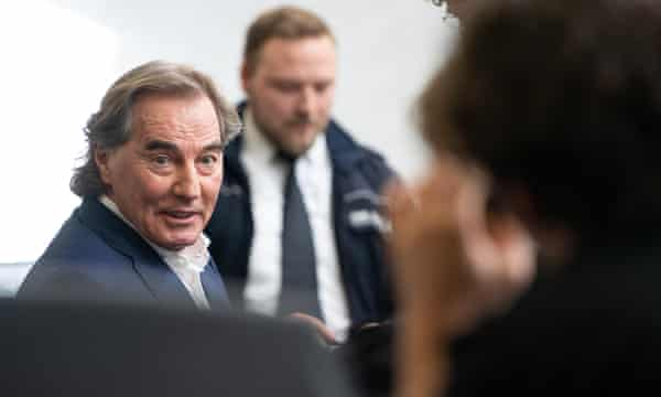 Jürgen Rudloff (left) sits in a courtroom in Stuttgart on the day of the sentencing in his trial for aiding and abetting human trafficking
