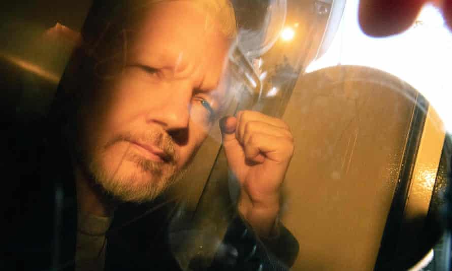 Julian Assange arrives at court on Wednesday