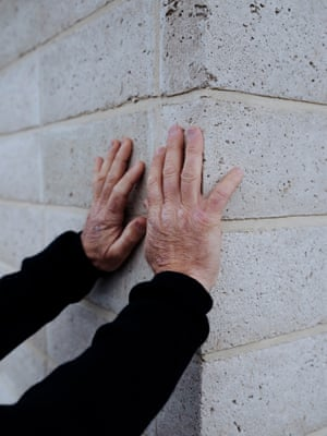 Builder Tony O'Connell, 53, inspects the masonry.