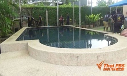 Police at the pool where Australian man Andrew Fenwick and his son Jason were found dead from electrocution southeast of Bangkok, Thailand