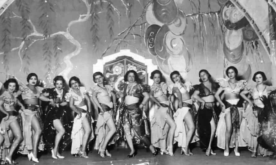 Cairo entertainer and nightclub owner Badia Masabni, centre, with her troupe.