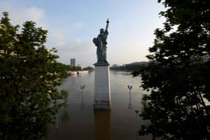 Another statue can be found in Paris, France, seen here in the flooded Seine river