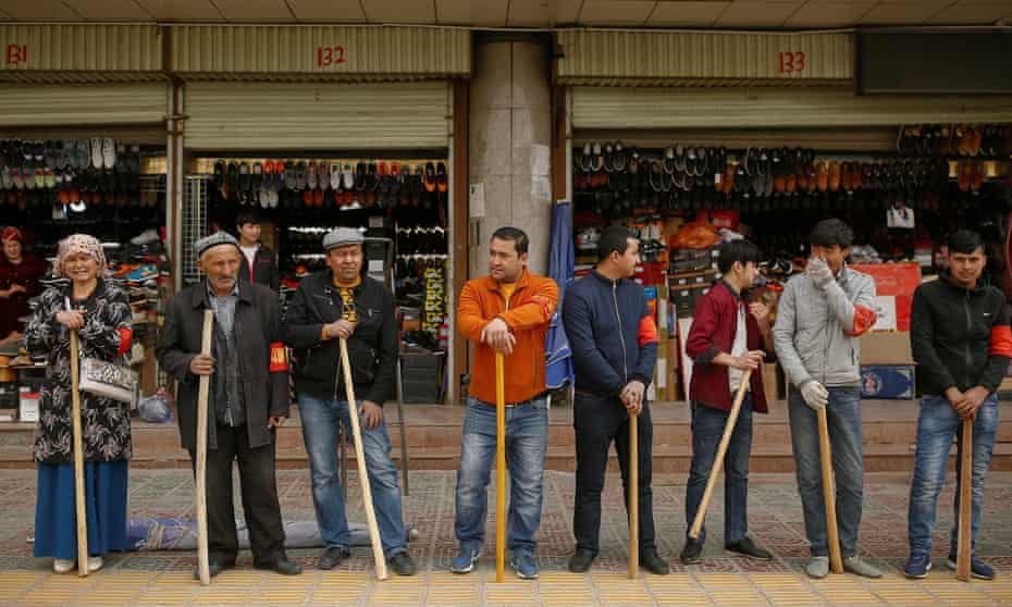 Shopkeepers perform daily anti-terror drill outside the bazaar in Kashgar, in March.