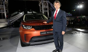 Dr Ralf Speth and a new bronze-coloured Land Rover Discovery vehicle