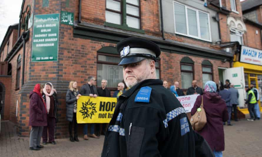 A police officer outside the Slade Road mosque in Birmingham