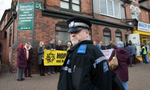 Police and activists outside Slade Road mosque, Birmingham, on Friday evening.
