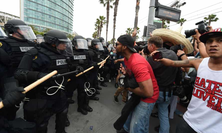 Protesters clash with police during a demonstration against Donald Trump outside his rally in San Diego.