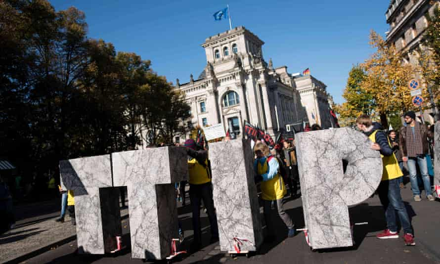 Protesters attend a rally against the proposed US-EU free trade pact in Berlin.