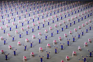 Participants perform during the 'Glorious Country' mass games held in conjunction with the 70th anniversary of the foundation of North Korea.