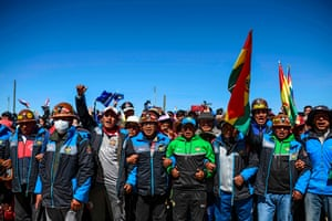 Supporters of the former president Evo Morales wait for his convoy on the road between Uyuni and Oruro in Bolivia. Morales crossed the border from Argentina into Bolivia on Monday, triumphantly ending a year-long exile that followed a failed bid for a controversial fourth term