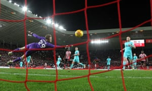Newcastle keeper Nathan Harker can not stop Sunderland scoring a third through Chris Maguire.
