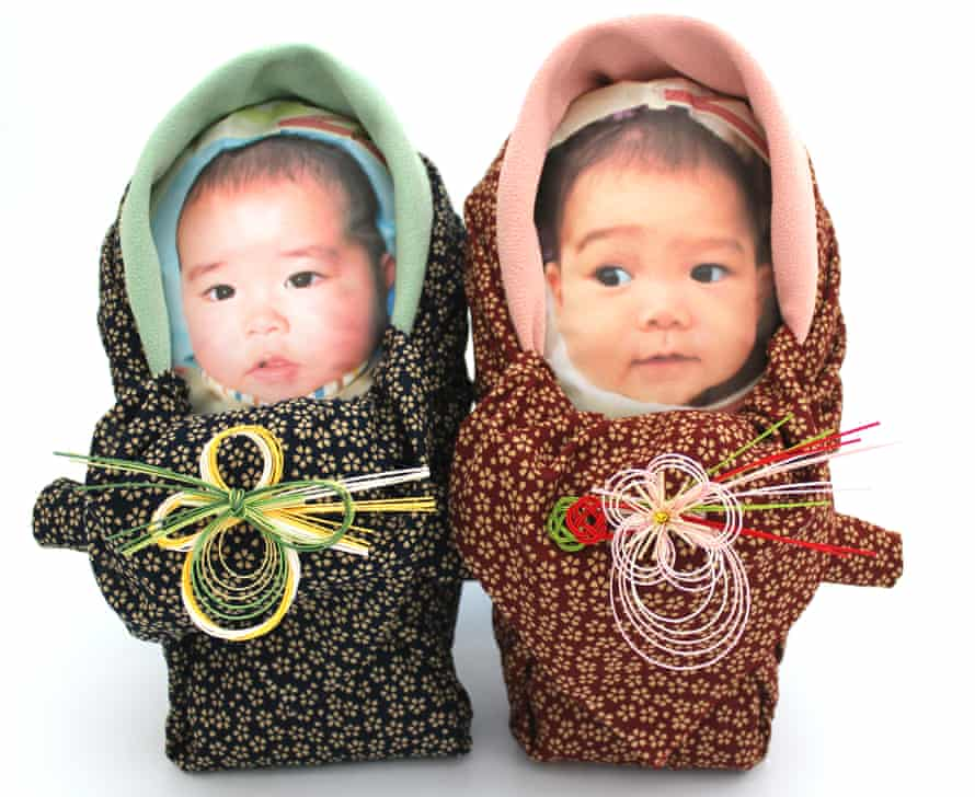 Rice babies wrapped in Japanese-style blankets.