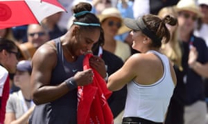 Canada's Bianca Andreescu consoles Serena Williams after the American's retirement at the Rogers Cup final