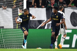 Kylian Mbappe runs back to the halfway line with Jemerson after scoring a nice goal.