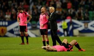 Barry Bannan looks dejected with manager Gordon Strachan after the match.