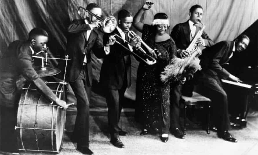 Ma Rainey Georgia Jazz Band pose for a studio group shot c 1924-25 with 'Gabriel', Albert Wynn, Dave Nelson, Ma Rainey, Ed Pollack and Thomas A Dorsey.
