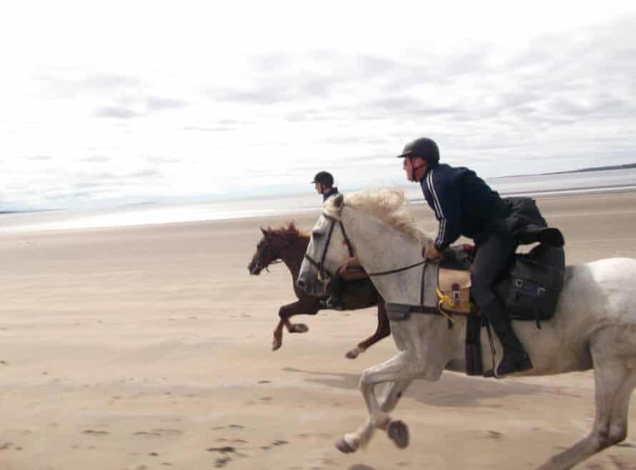 Horse riding by the sea, Ireland