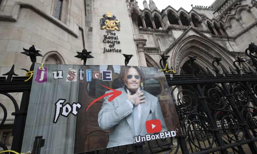 A poster on the railing of the Royal Courts of Justice in London