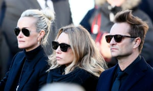 Johnny Hallyday's wife Laeticia, left, his daughter Laura Smet and son David Hallyday, right, attending the rocker's funeral last December