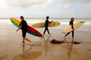 California, USHuntington Beach reopens after water-quality testing results showed non-detectable amounts of oil as surfers go back in the sea.