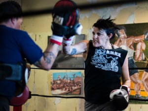 Kim, the owner of two bars in Dallas taking lessons from the boxing coach, Jeremy