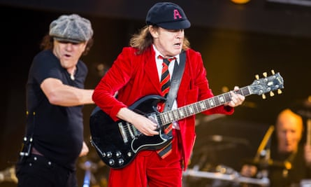 Brian Johnson and Angus Young of AC/DC perform live at Hampden Park in Glasgow, Scotland.