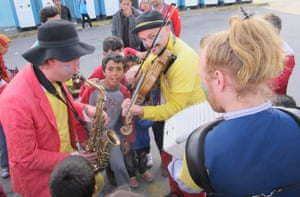 Musicians from Clowns Without Borders entertain children in Piraeus