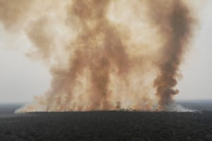 Smoke billows from a fire in an area of the Amazon jungle as it is cleared by loggers and farmers near Humaita, Amazonas State